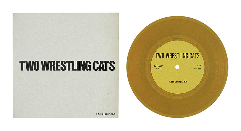 """Jack Goldstein – """"A Suite of Nine 7-Inch Records"""", 1976 45 rpm, different colored 7-inch vinyl detail: """"Two Wrestling Cats"""", 1976 45 rpm, yellow vinyl"""