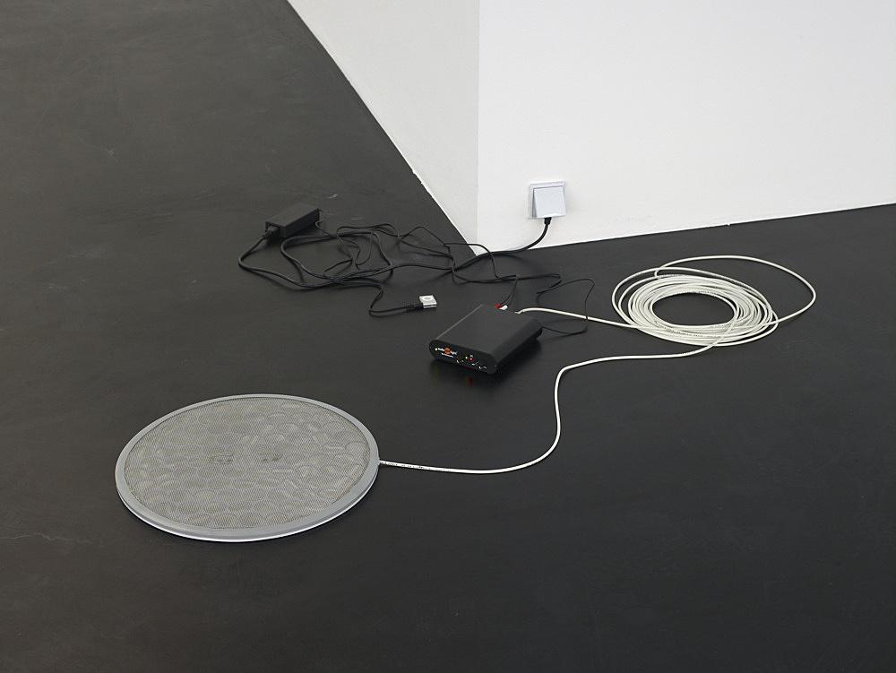 "Cerith Wyn Evans – ""Audio Column (frequency shifting paradigms in streaming audio)"", 2009 audio spotlight system/amplifier 45,5 cm diameter ""Permit yourself…"" installation view Galerie Daniel Buchholz, Elisenstraße 4-6, 2009"