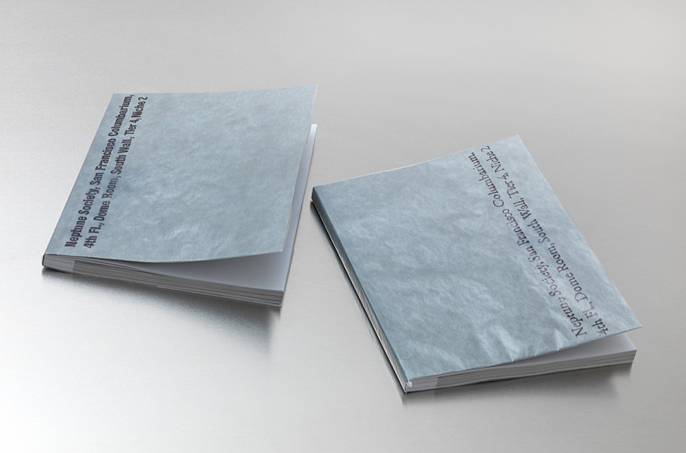 """– prototypes of the forthcoming publication: Julie Ault/Danh Vo/Heinz Peter Knes/Martin Wong """"I M U – U R 2"""" published by Galerie Buchholz, January 2013 prototypes wrapped in glassine paper inscribed by Phung Vo: 'Neptune Society, San Francisco Colombarium, 4th Fl., Dome Room, South Wall, Tier 4, Niche 2'"""