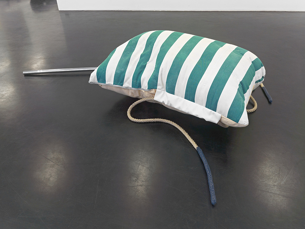 "Nairy Baghramian – ""Fluffing the Pillows C (Gurney, Silo)"", 2012 fabric, rubber, pleather, hemp rope, chromed pole dimensions installed variable 1 Silo: 50 x 90 x 130 cm 1 Gurney: 200 x 56 x 6 cm"