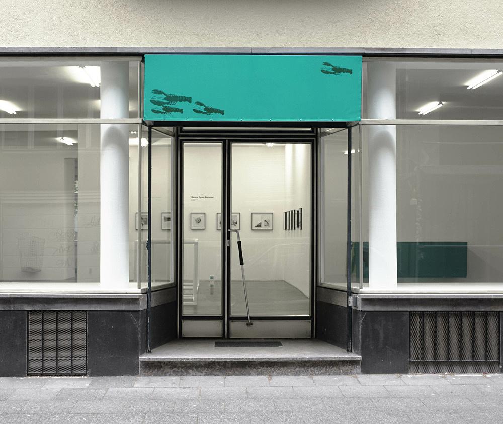 Reena Spaulings – Untitled, 2010 vinyl awning on aluminium construction, offset print on vinyl stickers and stenciled vinyl stickers 60 x 195 x 50 cm installation view Galerie Daniel Buchholz, Köln 2010