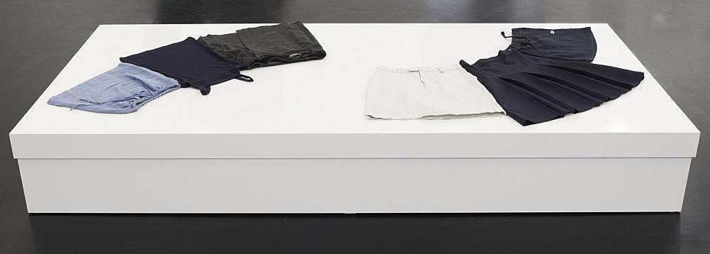 Cosima von Bonin / Michael Krebber – 3 CHILDREN'S SKIRTS / 1 CHILDREN'S FROCK & 2 CHILDREN'S SKIRTS, 1999 cotton, rayon, polyester plinth, wood, lacquer 28 x 100 x 200 cm