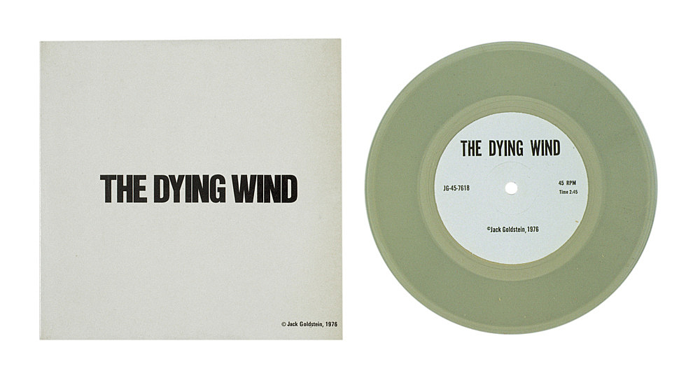 """Jack Goldstein – """"A Suite of Nine 7-Inch Records"""", 1976 45 rpm, different colored 7-inch vinyl detail: """"The Dying Wind"""", 1976 45 rpm, clear vinyl"""