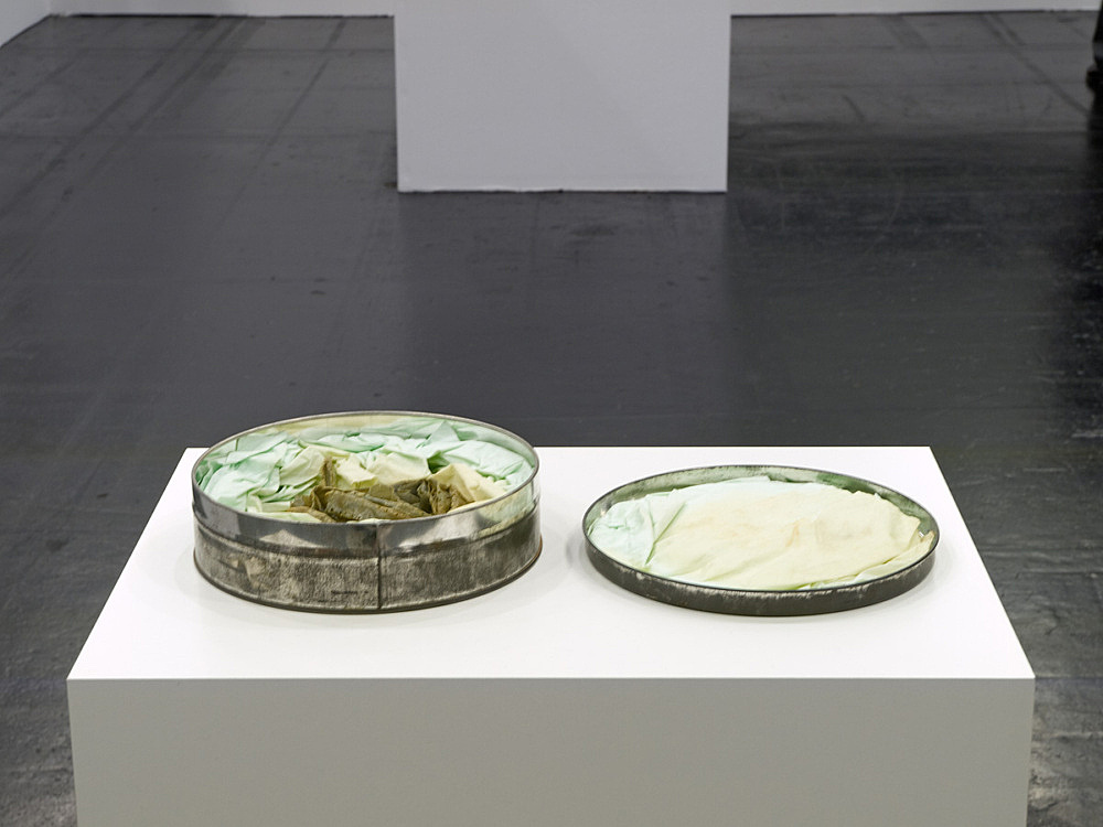 "Tony Conrad – ""Deep Fried, 7360"", 1973 film in film can h=4.5, Ø19.5cm installation view Galerie Daniel Buchholz, Art Cologne 2008"