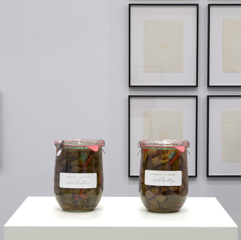 "Tony Conrad – ""Pickled E.K. 7302-244-0502 (#3)"", 2006 & ""Pickled E.K. 7302-244-0502 (#10)"", 2006 pickled celluloid film strip in preserving jar installation view Galerie Daniel Buchholz, Art Cologne 2008"