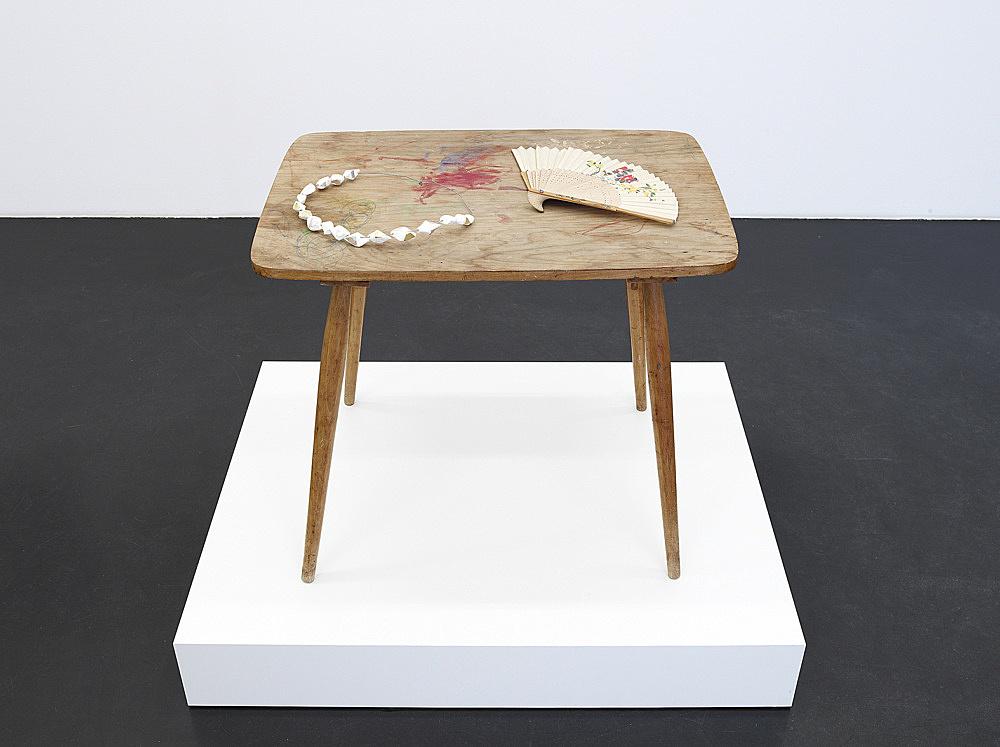 """Cosima von Bonin – """"Der Oberlehrer"""", 1992 wooden table, polystyrene, metal, fan 63 x 70 x 49,5 cm pedestal 15 x 100 x 80 cm"""