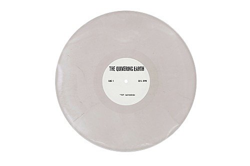 """Jack Goldstein – """"The Quivering Earth"""", 1977 33 1/3 rpm record, white vinyl with an uncropped silver edge"""
