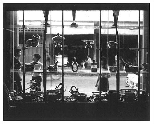 """Boys seen through a shop window"""