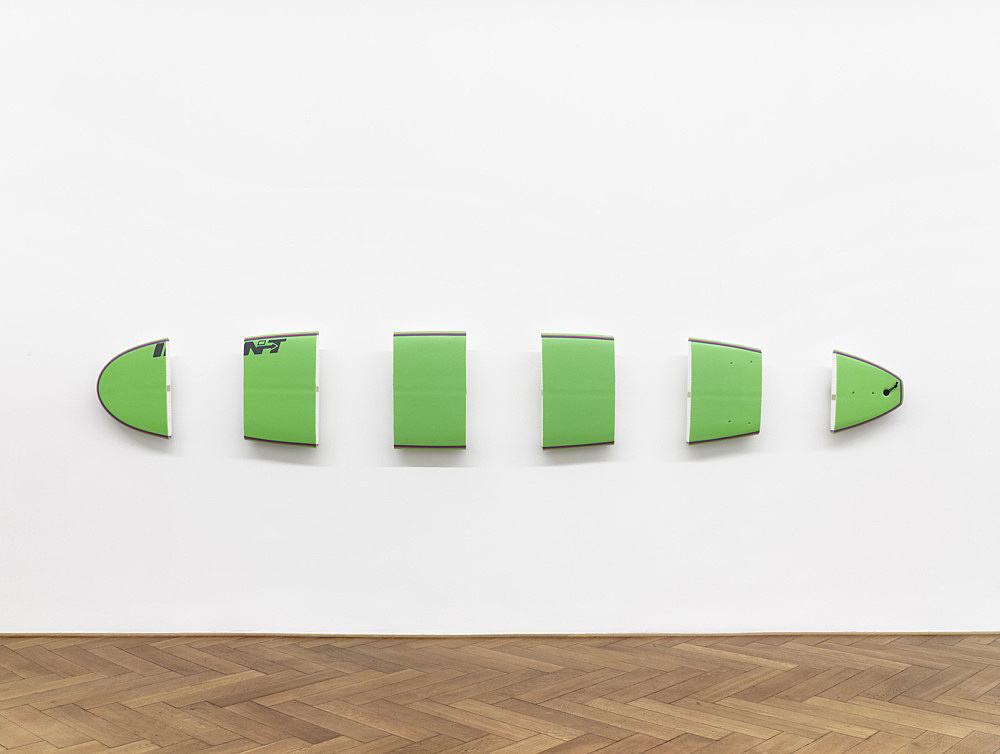 "Michael Krebber – ""INT (green)"", 2010 surfboard , 6 parts lacquer, styrofoam, plastic, metal dimensions as installed: 58 x 395 x 14 cm"