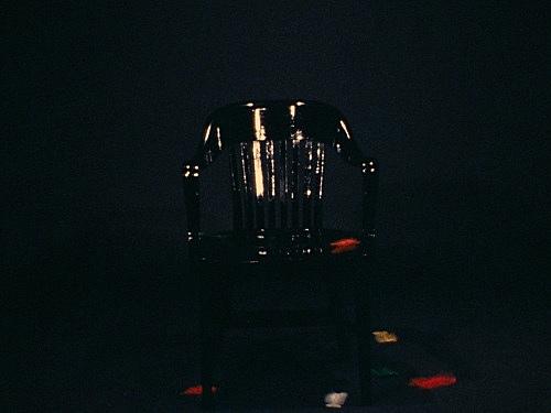 """Jack Goldstein – """"A Set of ten 16mm-films"""", 1974-1978 """"The Chair"""", 1975 16mm, color, silent, 5' filmstill"""