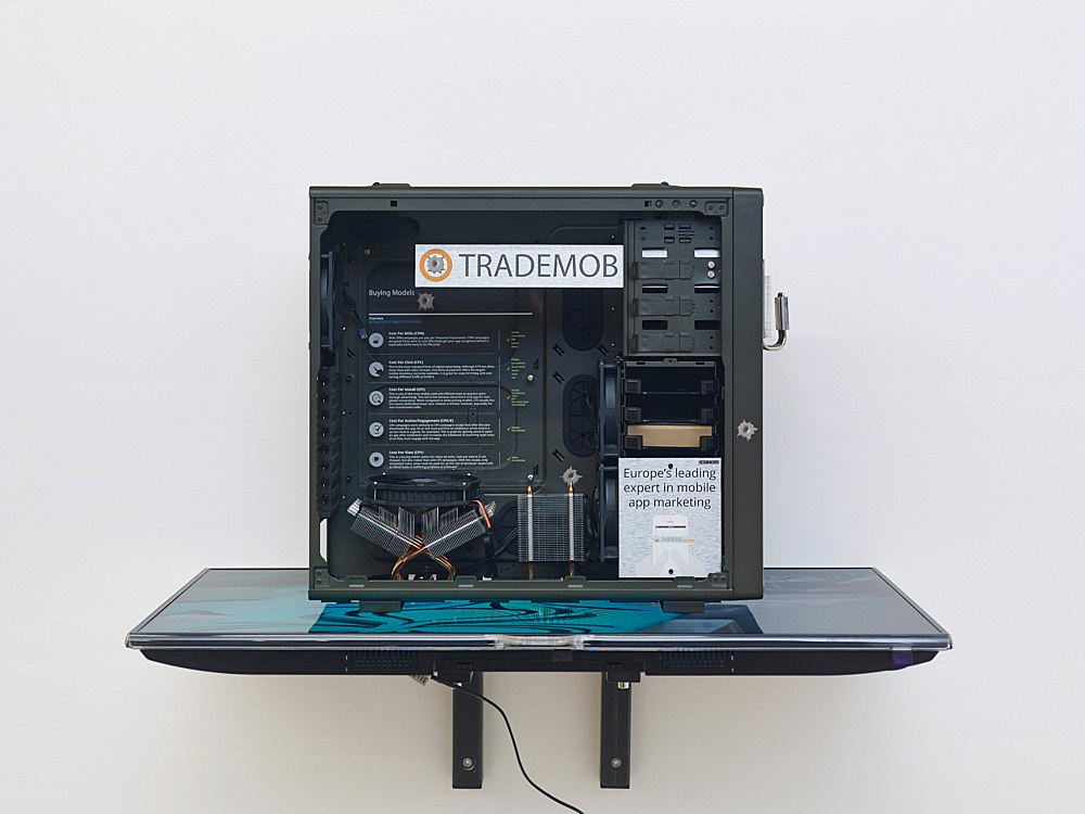 "Simon Denny – ""Berlin Startup Case Mod: Trademob"", 2014 custom computer case, heavy-duty computer hardware, metal fittings, digital prints on alu-dibond, Samsung UE40F6500 SS, video on USB stick 79,5 x 91 x 54 cm"