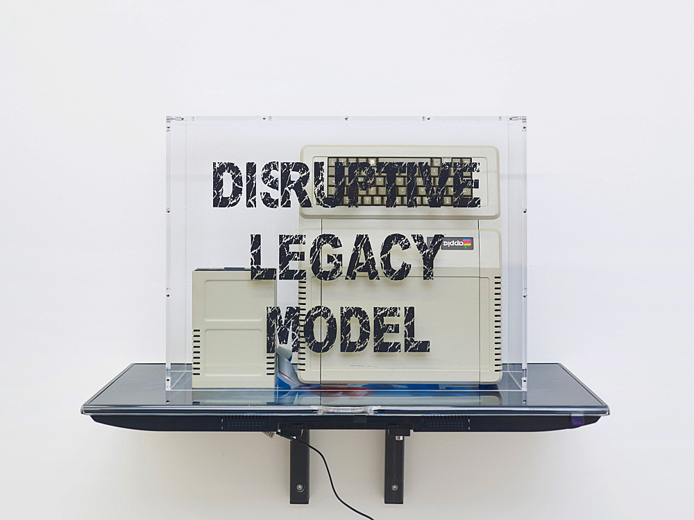 "Simon Denny – ""Disruptive Legacy Model: Apple IIe"", 2014 Apple IIe Computer (acquired in Christie's First Byte: Iconic Technology From the Twentieth Century Online Auction – Sale 773429), custom plexiglas box with digital print, Samsung UE40F6500 SS, video on USB stick 80 x 91 x 54 cm"