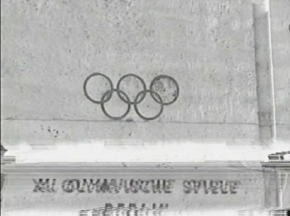 """Lutz Bacher – """"Olympiad"""", 1997 Hi8 color remastered to Betacam SP b&w, silent 36 minutes, looped video still"""