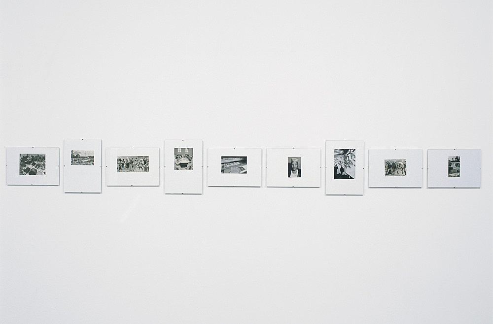 "Isa Genzken – ""Der Spiegel I"", 1989-1991 series of 121 illustrations from the news magazine 'Der Spiegel' (1989-1991) b/w, mounted on cardboard under glass each 29,7 x 21 cm installation view Art Basel, Art Unlimited 2001"