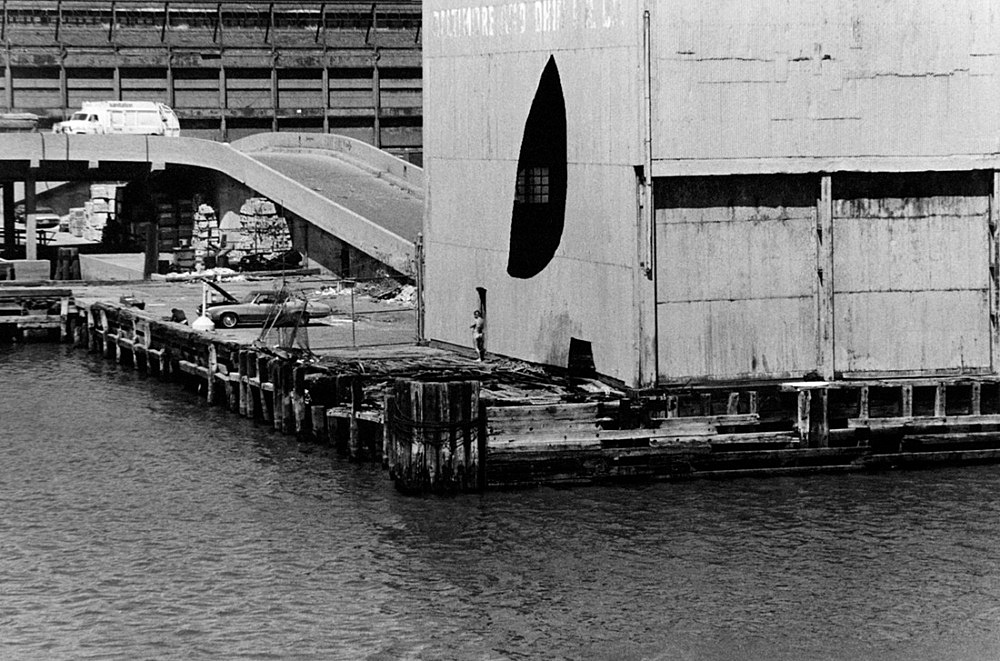 "Alvin Baltrop – ""Pier 52 (Gordon Matta-Clark's 'Day's End' building cuts with nude man)"", 1975-1986 silver gelatin print 16 x 10 cm"