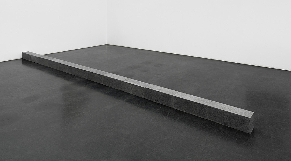 """Carl Andre – """"Houghs Neck, New York"""", 1992 quincy granite, 12 units each: 15.24 x 45.72 x 15.24 cm; overall: 15.24 x 548.64 x 15.24 cm"""