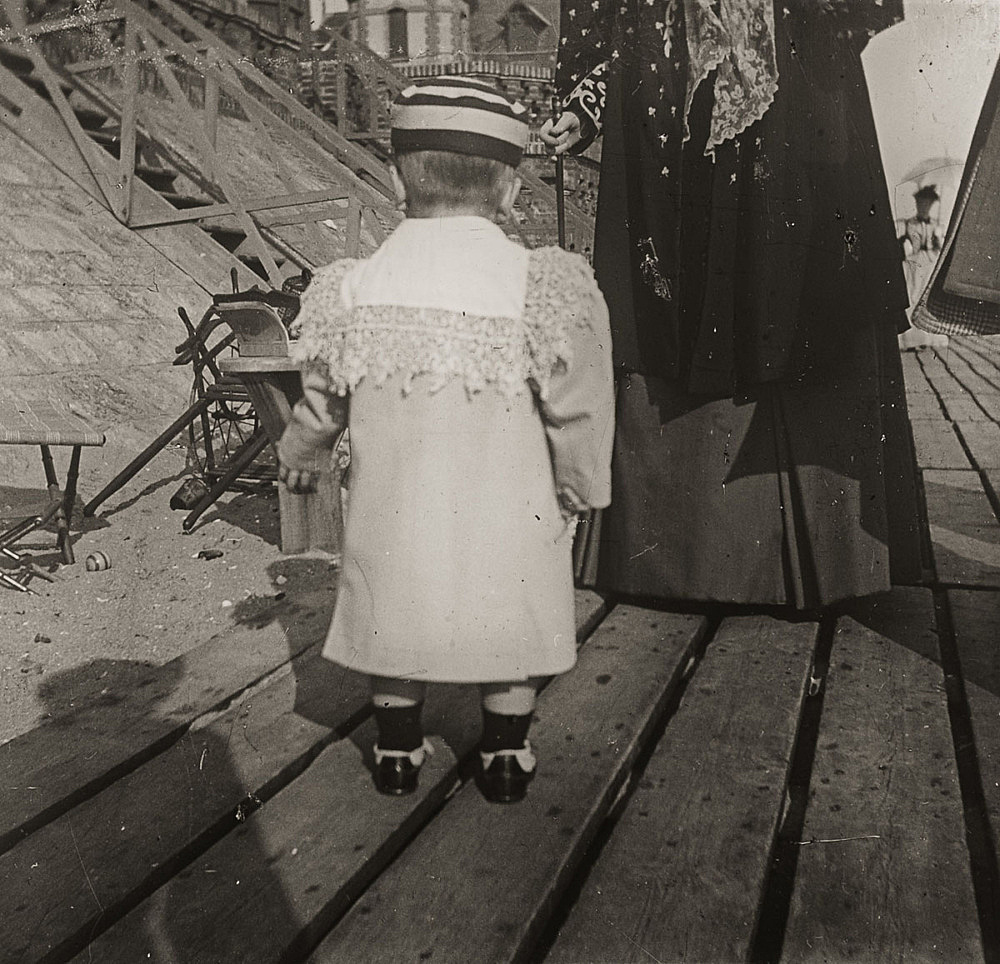 "– ""Raymond Roussel's mother Marguerite and his nephew, Robert de Breteuil on the beach in Dieppe, Normandy"", ca. 1900 b/w photograph"