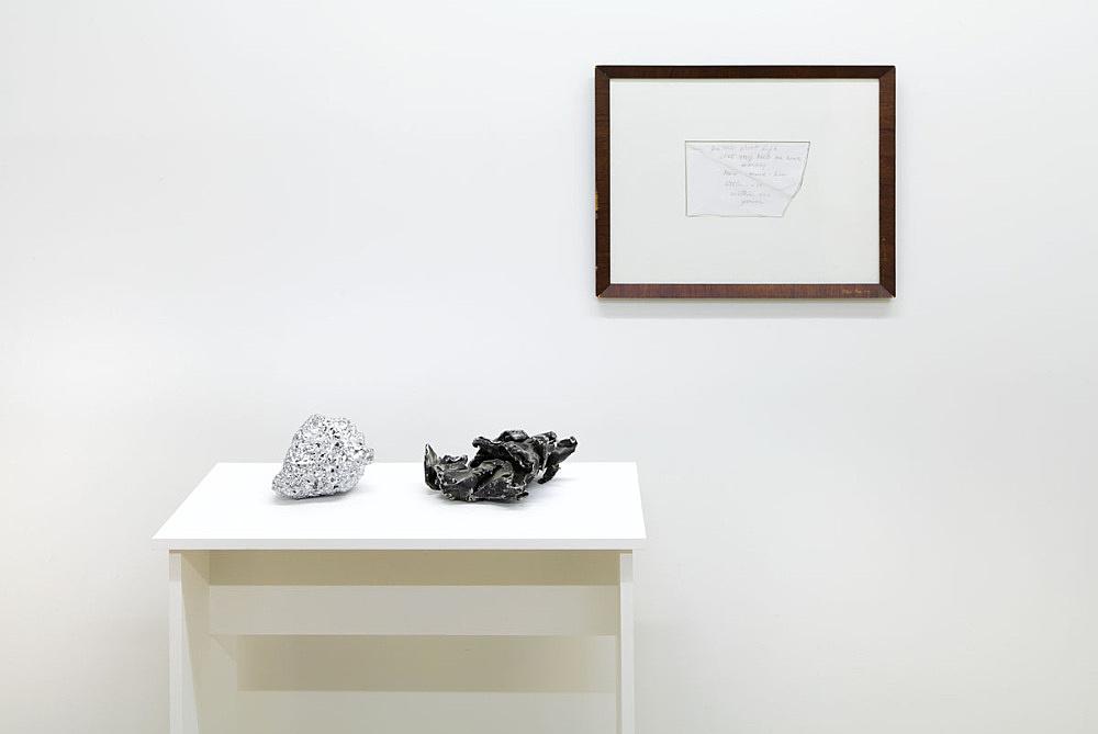 "James Benning – ""Untitled Love"", 2014 chromed rock, B-52 fragment, pencil on envelope in artist frame installation view Galerie Buchholz, New York 2015"