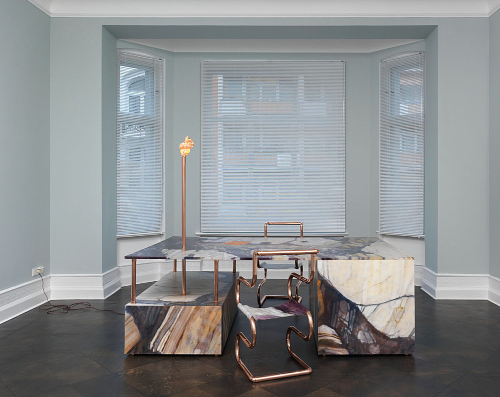 """Lucy McKenzie – """"Quodlibet LX (Violet Breche Desk)"""", 2015 oil on canvas stretched on MDF, copper, shell, light-bulb, cable 190 x 240 x 160 cm chairs: copper, oil on canvas 97 x 50 x 50 cm each installation view Galerie Buchholz, Berlin 2015"""