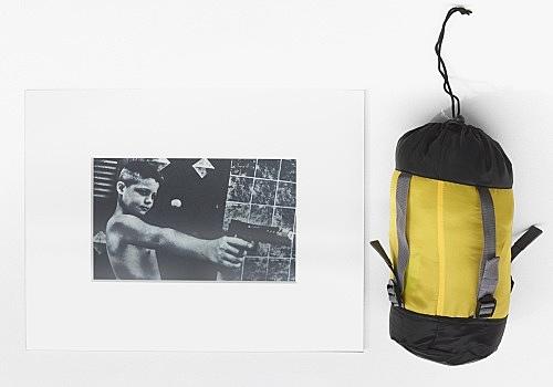"Anne Imhof – ""Babydream"", 2016 computer printout, mat, glass, 40 x 50 x 1 cm sleeping bag 52 x 16 x 18 cm dimensions as installed 40 x 72 cm"