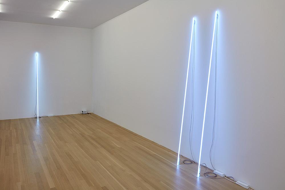 "Cerith Wyn Evans – ""Leaning Horizon (neon 6500 Kelvin, 1.95 m)"", 2015 neon height 195 cm, diameter 1.2 cm & ""Leaning Horizon (neon 8000 Kelvin, 2.2 m)"", 2015 2 parts, neon each: height 220 cm, diameter 1.2 cm distance between each: 41 cm installation view Galerie Buchholz, New York 2016"