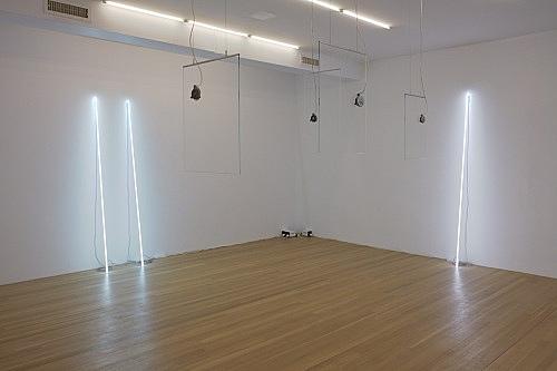 "Cerith Wyn Evans – ""Leaning Horizon (neon 5500 Kelvin, 2.2 m)"", 2015 neon height 220 cm, diameter 1.2 cm & ""Leaning Horizon (neon 5500 Kelvin, 2.2 m)"", 2015 neon height 220 cm, diameter 1.2 cm installation view Galerie Buchholz, New York 2016"
