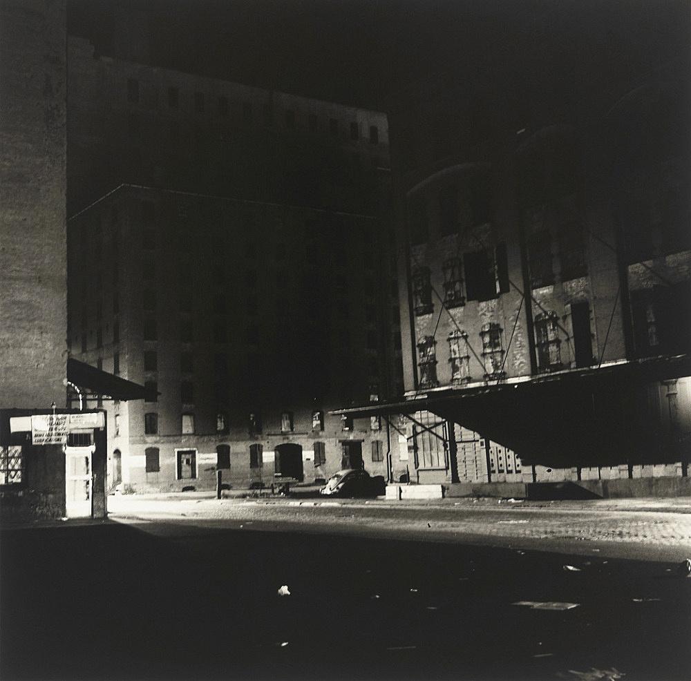 """Peter Hujar – """"Loading Dock at Night"""", 1976 gelatin-silver print 36.8 x 36.8 cm (image), 50.8 x 40.6 cm, (sheet)"""
