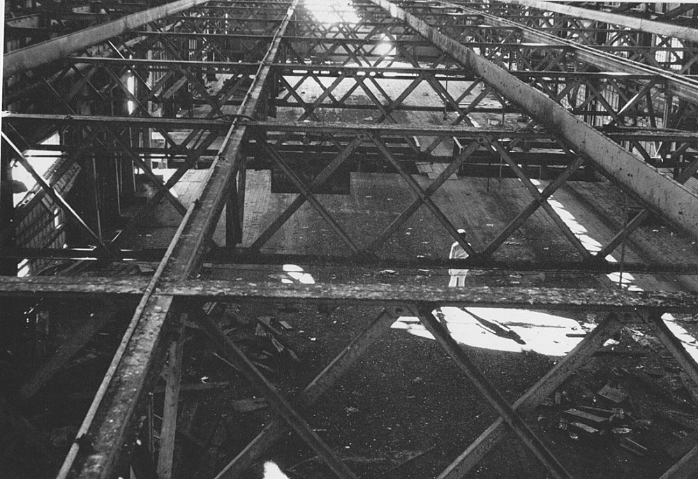 "Alvin Baltrop – ""Pier 52 (with Gordon Matta-Clark's 'Day's End' building cut"", 1975 – 1986 silver gelatin print (vintage print) 11.2 x 16.7 cm"