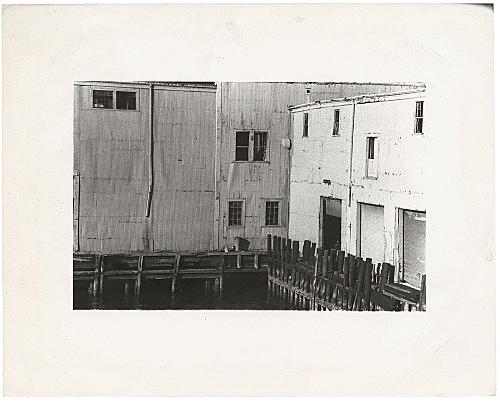 Alvin Baltrop – The Piers (exterior with four figures), n.d. (1975-1986) silver gelatin print image size: 10.5 x 18.1 cm paper size: 20 x 25.4 cm (framed: 35.3 x 40.4 x 2.8 cm)