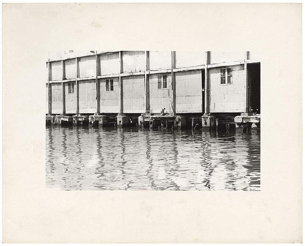 Alvin Baltrop – The Piers (exterior with couple having sex), n.d. (1975-1986) silver gelatin print image size: 11.7 x 18 cm paper size: 20.5 x 25.5 cm (framed: 35.3 x 40.4 x 2.8 cm)