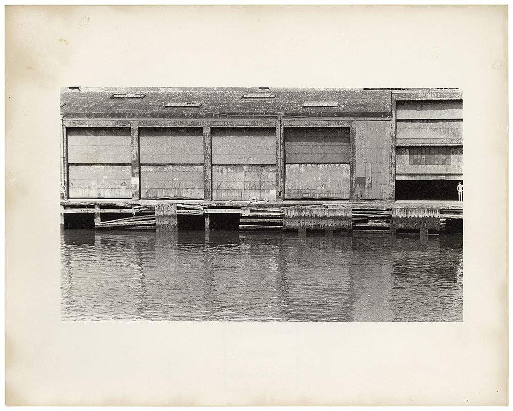 Alvin Baltrop – The Piers (figure at far right), n.d. (1975-1986) silver gelatin print image size: 10.5 x 20.3 cm paper size: 20.3 x 25.4 cm (framed: 35.3 x 40.4 x 2.8 cm)