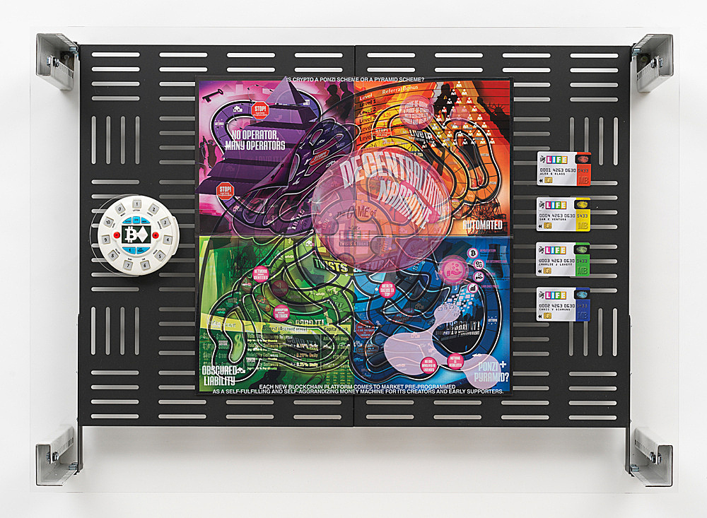"Simon Denny – ""Crypto Futures Game of Life Board Overprint Collage: Twists and Turns"", 2018 digital print on Milton Bradley's Game of Life Twists and Turns board, spinner and bank cards, powder-coated server rack shelving, laser cut Plexiglas, various server rack hardware components 72 x 100 x 23 cm"