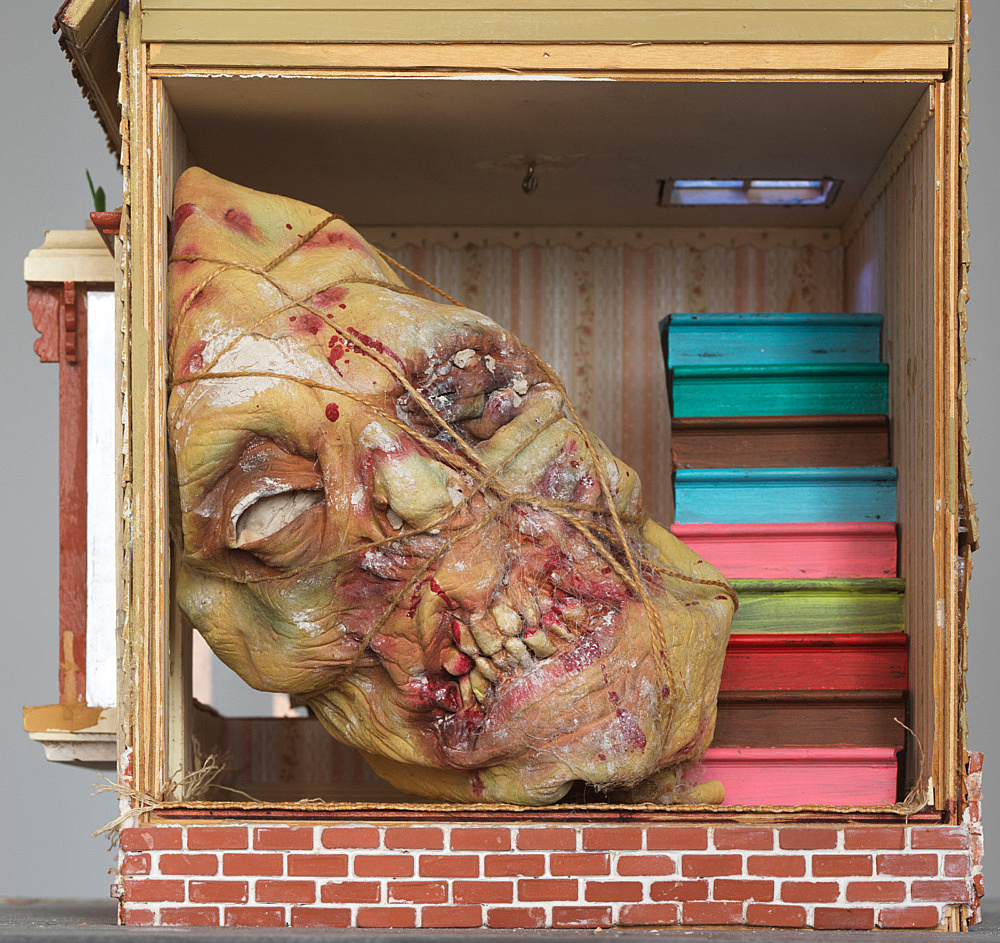 """Richard Hawkins – """"Shibusawa's House"""", 2018 doll house, rubber mask, clay, twine, electric lightning and mixed media on card table 122 x 86.5 x 86.5 cm detail"""