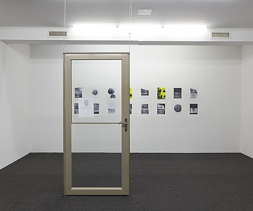 "Henrik Olesen – ""Door"", 2019 print on paper on metal door, hardware 203.2 x 94 x 7.6 cm & ""A Forest"", 2019 16 collages on paper, 2 silkscreens and 14 laserjet prints each 29.7 x 21 cm overall: 68.8 x 320 cm installation view Galerie Buchholz, New York 2019"