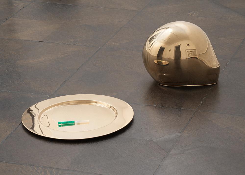 """Anne Imhof – """"Untitled (Imagine)"""", 2019 bronze cast unique plate: 1,5 x 44,5 cm, helmet: 25 x 31 x 25 cm"""