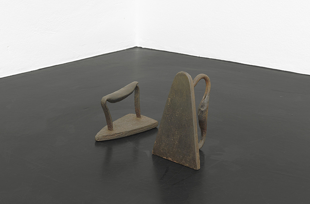 """Cameron Rowland – """"Out of sight"""", 2020 19th-century slave iron, 19th-century slave iron with missing rattle 13,5 (h) x 28 (w) x 15 (d) cm Irons with rattles built into their handles, called slave irons, were designed to be used by the enslaved working inside the plantation house to iron the laundry of the masters. While out of sight, the rattle audibly signaled to the master that the slave was working continuously. Removing the rattle was a refusal of this oversight. Rental"""
