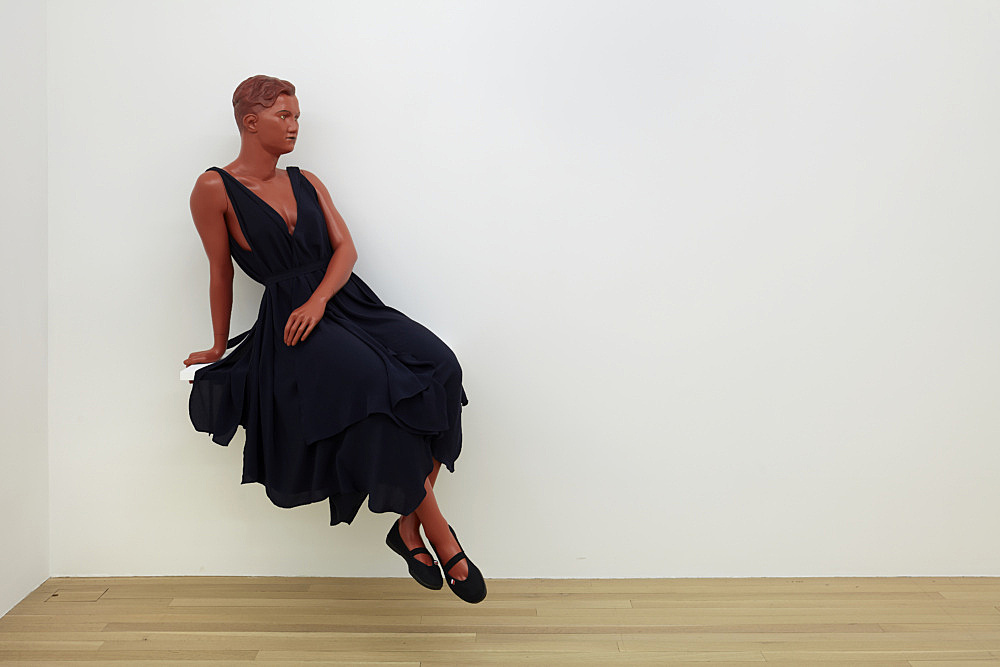 """Lucy McKenzie – """"Sitting Mannequin (Greek pottery / Quatre Mouchoirs)"""", 2021 fibreglass, acrylic and oil paint, belted silk dress, gym shoes mannequin dimensions: 145 x 85 x 67 cm shelf dimensions: 2.5 x 91.4 x 61 cm overall dimensions: 165 x 85 x 67 cm installation view Galerie Buchholz, New York 2021"""