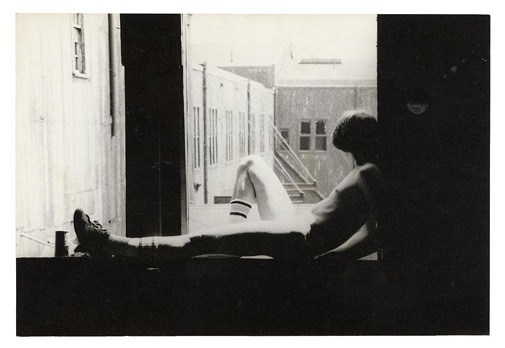 "Alvin Baltrop – ""The Piers (man sitting on windowsill)"", n.d. (1975-1986) silver gelatin print 11.8 x 17.2 cm"