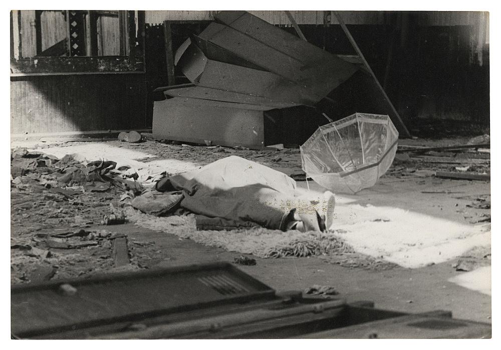 "Alvin Baltrop – ""The Piers (body under cloth, umbrella)"", n.d. (1975-1986) silver gelatin print 11.8 x 16.8 cm"