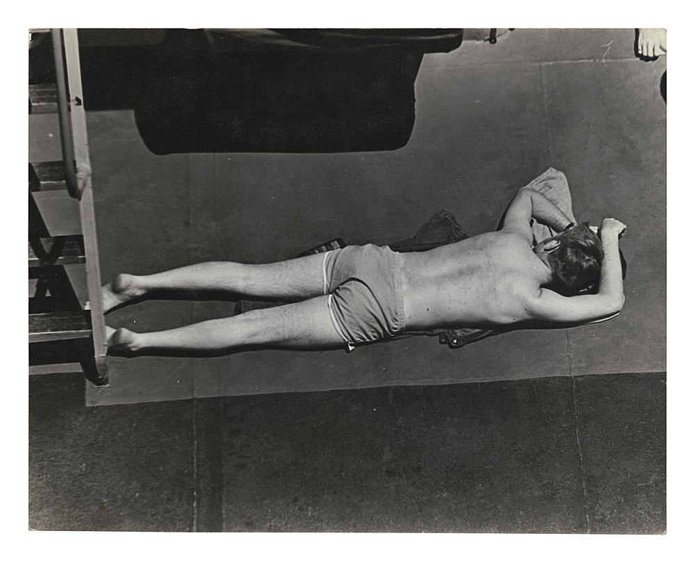 "Alvin Baltrop – ""The Navy (man lying on deck)"", n.d. (1969-1972) silver gelatin print 12 x 17 cm"