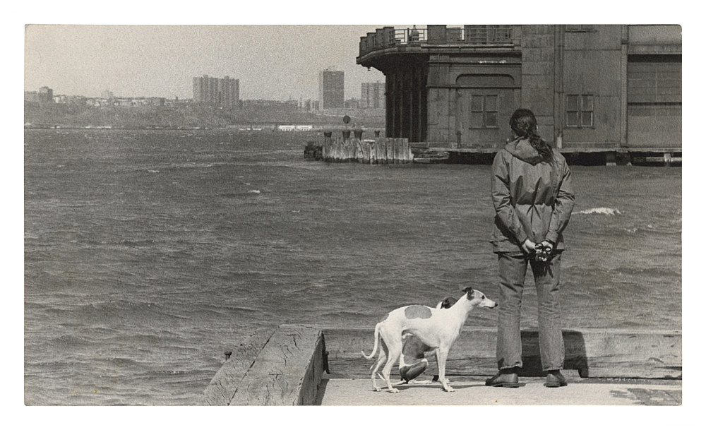 """Alvin Baltrop – """"The Piers (man with two dogs, looking across water)"""", n.d. (1975-1984) silver gelatin print 11.3 x 19.6 cm"""