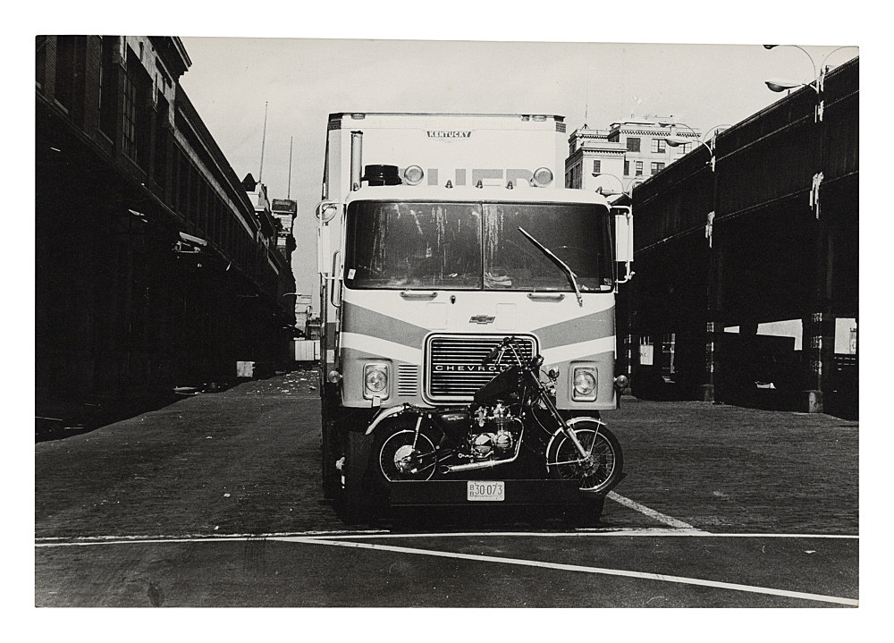 """Alvin Baltrop – """"Truck with motorcycle, elevated west side highway"""", n.d. (1975-1986) silver gelatin print 11.6 x 17 cm"""