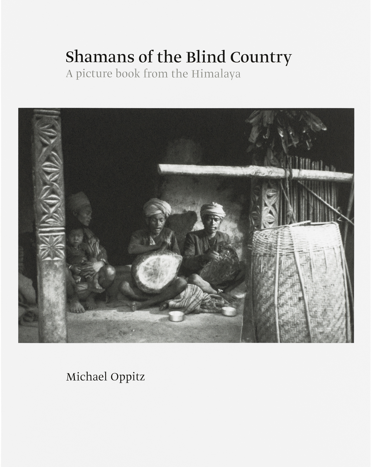 """Michael Oppitz – Shamans of the Blind Country A Picture book from the Himalaya 2021, 384 pages, hardcover, dust jacket, fully illustrated in b/w, 23 x 28,5 cm 2021, 384 pages, owrps, fully illustrated in b/w, 23 x 28,5 cm Euro 58,- (hardcover) / Euro 48,- (softcover) – This book focuses on the extraordinary mythical traditions and ritual practices in a remote community in the Himalayan mountains, studied over a long period of field research by Michael Oppitz. It is the English version of his German original, first published in 1980 by Syndikat Verlag under the title """"Schamanen im Blinden Land"""". That book came out in parallel to a film of the same name, today considered a classic. Now appearing in English as """"Shamans of the Blind Country. A picture book from the Himalaya"""" the new version extends the old by more than a third of the original documentary photographs; it traces the historical changes that have transformed this mountainous region of Nepal over the last four decades in an extensive epilogue; and it suggests a wider context of ritual healing in the Himalaya by appending a selection of early pictures of shamanism in Siberia. This English version is published in both hardcover and softcover editions."""
